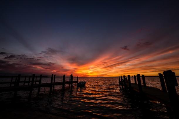photo coucher de soleil nuage mer ponton orange orangé ciel